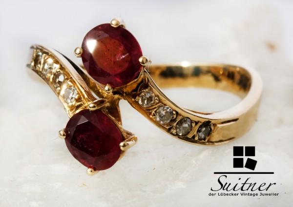 wertvoller Cross over Ring mit 2 Rubinen und Diamanten in 585 Gold